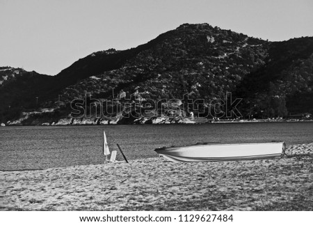 Lonely Boat On The Beach -  Black & White           #1129627484