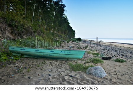 Lonely boat on Vidzeme's beach of Baltic Sea, Latvia, Europe