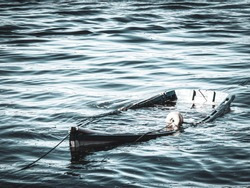 lonely boat, sunk and abandoned