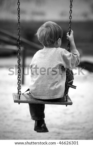 Lonely boy in the park, black and white photo - stock photo