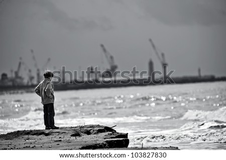 Lonely Boy Standing,Relaxing And Viewing The Water Of The Ocean ...