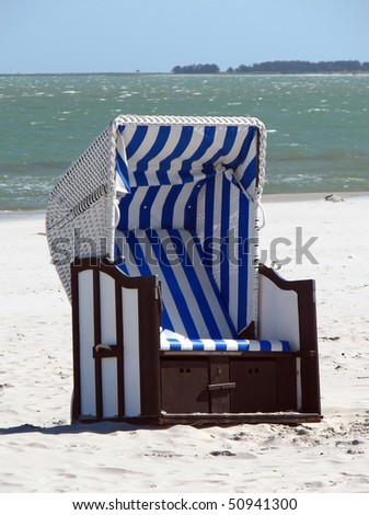 Lonely canopied beach chair - stock photo