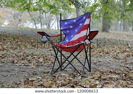 Lonely Chair in Central Park, N.Y.Back made from American flag