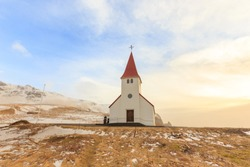 Lonely countryside church on hill in winter at Vik (Vik i Myrdal) Iceland.