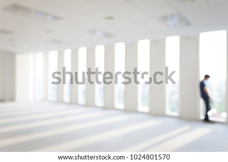 Lonely Depressive Man, Sad, tired in room near window, Major depressive disorder (MDD), Defocused. Blurred background.