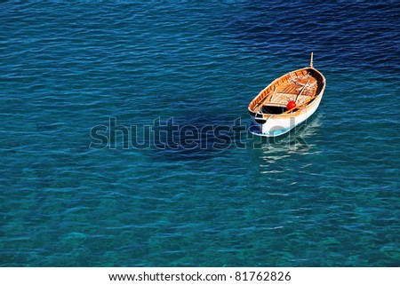 Lonely fishing boat #81762826