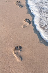 Lonely footprints on the coast. Leisure at sea. End of coronavirus quarantine. the effect of civid-19 on the beach season 2020. Completion of isolation. Summer sea vacation