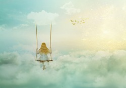Lonely girl sitting on the swing above clouds; fantasy/solitude/surreal background with copy space