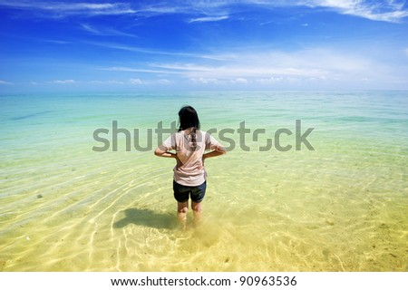 Lonely girl standing in sea