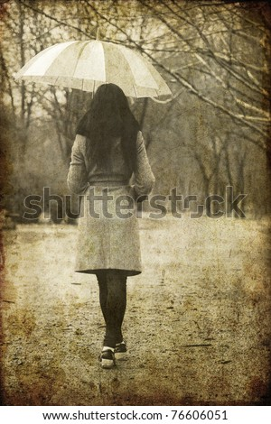 Lonely girl walking at alley in the park in rainy day. Photo in image style.