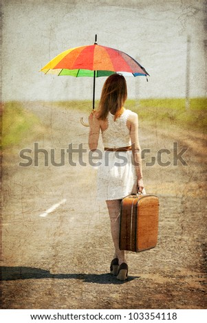 lonely girl with suitcase and...