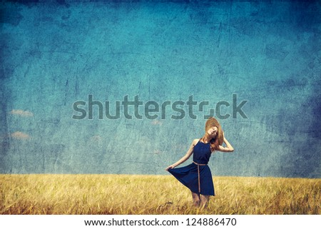 Lonely girl with suitcase at country. Photo in old color image style.