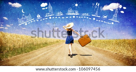lonely girl with suitcase at...