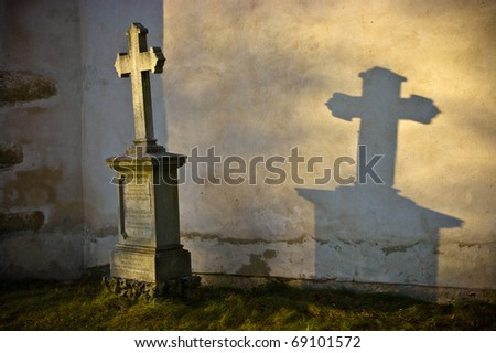 Lonely grave in rays of sunshine