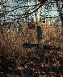 Lonely grave on the old  cemetery in the field