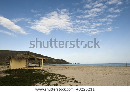 stock-photo-lonely-house-in-a-beach-with-blue-sky-48225211.jpg