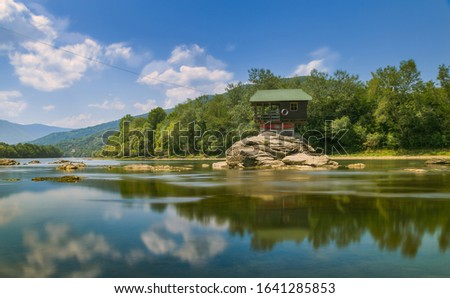 lonely house in middle of the river. Drina house, little house on the rock on the middle of the Drina river in west Serbia, Bajina Basta, near mountain Tara, one of the most popular attractions.  Stock photo ©