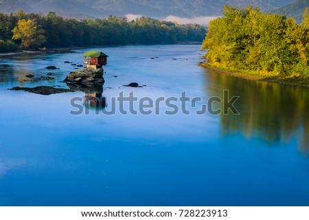 Lonely house on the river Drina in Bajina Basta, Serbia Stock photo ©