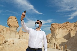 Lonely male tourist at Al Qarah Mountain in Eastern province of Saudi Arabia