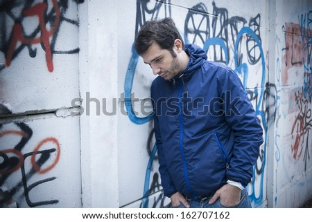 lonely man in city street stock photo