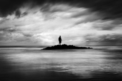 Lonely man on the beach finding solitude and peace