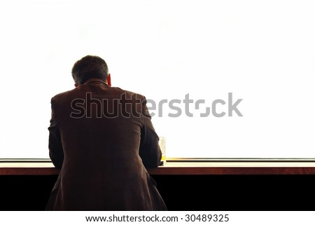 lonely man sitting at the table