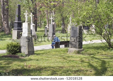 Lonely Man Sitting In a Cemetery