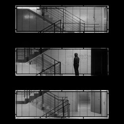Lonely man standing on an industrial midnight staircase