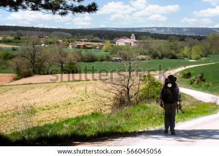 Shutterstock Lonely Pilgrim walking the Camino de Santiago in Spain on a beautiful summer day.