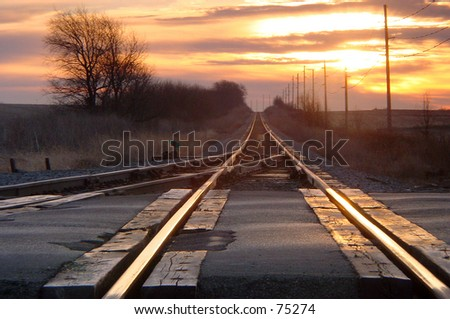 Lonely railroad crossing on cold winter morning