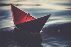 Lonely red paper boat