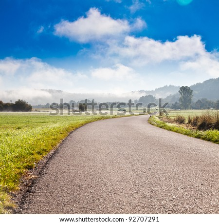 Lonely road in southern germany - stock photo