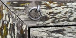 lonely rusty steel ring near water