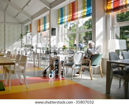 lonely senior in cafe of elderly house #35807032