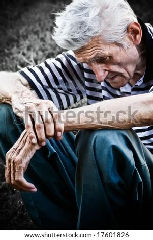 Lonely senior man feeling very sad
