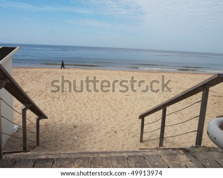 Lonely silhouette and the sea, Ostend, Belgium - stock photo