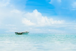 Lonely small boat in ocean.