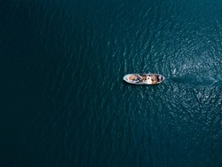 Lonely small fishing boat in the sea, shot in the air