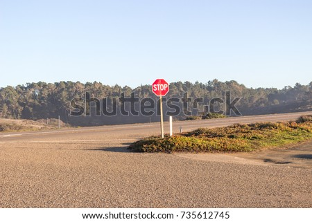 Lonely stop sign somewhere at route 1 or route 101 in California, USA #735612745