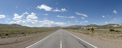 Lonely straight and long road under a blue sky in Patagonian Argentina