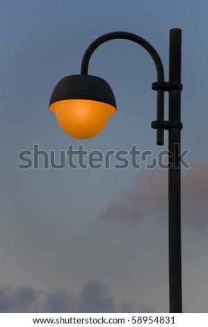 Lonely street lantern on dark sky background