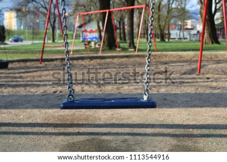 Lonely swing at the playground #1113544916