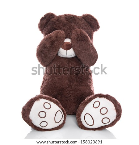 Lonely teddy bear covering eyes isolated on white background sadness or problems concept