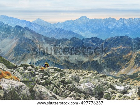 lonely tourist enjoys stunning panorama of Mieguszowiecki Grand Peak from Goat Peak, High Tatras, Zakopane, Poland #497776237