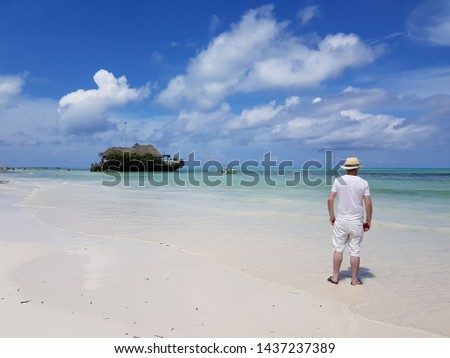 Lonely tourist in a lonely planet.. a man reminiscing by the sea...