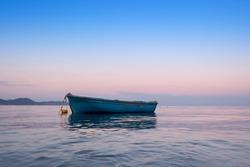 Lonely traditional greek fishing boat on sea water, Zakynthos island, Greece