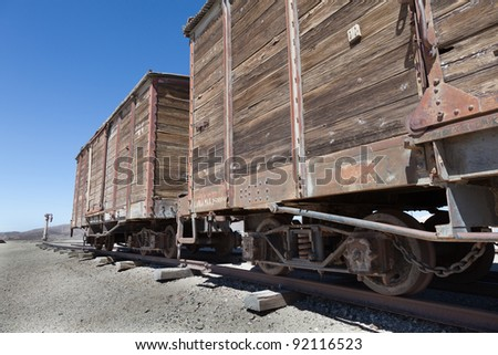 Lonely Train in the desert and wagons