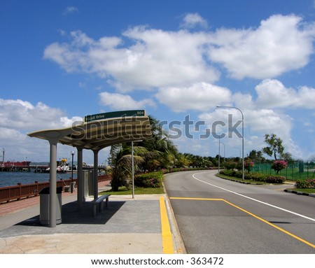 Lonely wait at a bus stop in Singapore amidst the clouds of blue - stock photo
