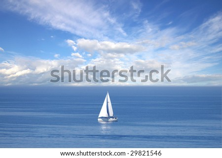 Lonely white sail at infinite ocean