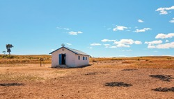 Lonely white single small chapel at flat African land away from Ilakaka town, on a sunny day
